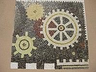 1170 Lascygasse 30-34 Stg. 1 - Mosaikhauszeichen Zahnräder von Karl Bednarik 1957 IMG 4496.jpg