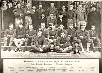 1st Grey Cup - The 1909 Varsity Blues, inaugural champions.  The Grey Cup is pictured at the front right.