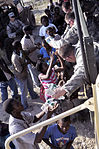 2-319th, Black Falcons, Deliver Much Needed Food and Water in Port-au-Prince DVIDS246874.jpg