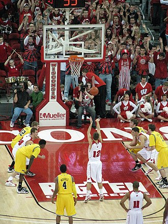 Key (basketball) - Jason Bohannon shoots a free throw; in the American NCAA, there can be at most three players on each side of the key during a free throw.