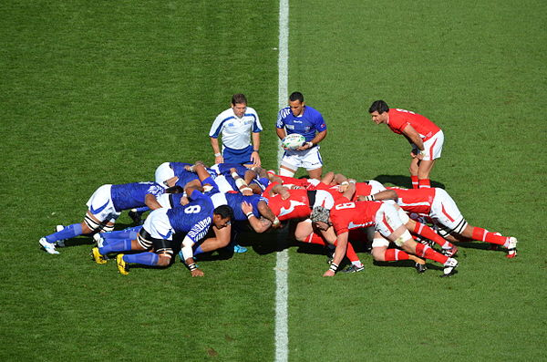 A scrum between Samoa (in blue) and Wales (in red) during the 2011 World Cup 2011 Rugby World Cup Wales vs Samoa (6168183024).jpg