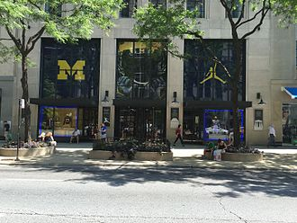 Jumpman (logo) - Michigan Wolverines logo and the jumpman logo at the Nike flagship store on the Magnificent Mile during the week before the opening game for the 2016 Michigan Wolverines football team.