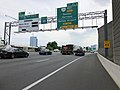 2019-05-29 17 05 47 View south along the outer loop of the Capital Beltway (Interstate 495) at Exit 45A (Virginia State Route 267 West, Reston, Herndon, Dulles Airport) in McLean, Fairfax County, Virginia.jpg