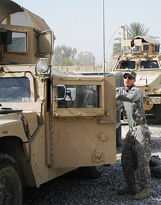 34th Infantry Division Band - 34th ID Band Soldier prepares to convoy at FOB Husiniyah, Iraq.