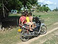 3 children on a motorbike.jpg