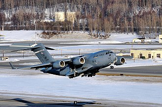 3rd Wing - A 517th Airlift Squadron C-17 Globemaster III taking off from Elmendorf Field