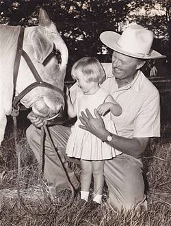 7th Duke of Montrose with his daughter patting a brahman bull.jpg