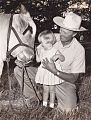 7th Duke of Montrose with his daughter patting a brahman bull.jpg