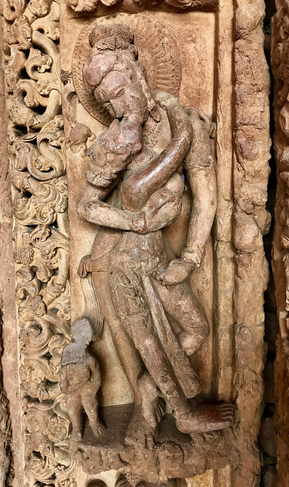 8th century couple embraced and mouth kissing at Tivara Deva temple, she stands on his feet, Sirpur monuments Chhattisgarh India