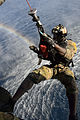 A U.S. Air Force pararescueman assigned to the 82nd Expeditionary Rescue Squadron (ERQS) is lowered into the water from an HH-60G Pave Hawk helicopter assigned to the 303rd ERQS as part of a water rescue 140322-F-VY794-437.jpg