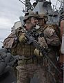 A U.S. Marine, right, assigned to the 13th Marine Expeditionary Unit embarked aboard the amphibious assault ship USS Boxer (LHD 4) provides instructions to a teammate during a visit, board, search and seizure 140112-N-PW661-074.jpg