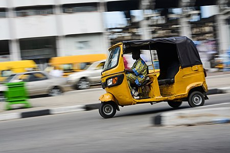 A commercial tricycle operator in Lagos Nigeria.jpg