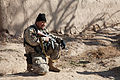 A member of the Afghan National Civil Order Police takes a knee during a patrol in the Maiwand district, Kandahar province, Afghanistan, Feb 120225-A-QD683-029.jpg