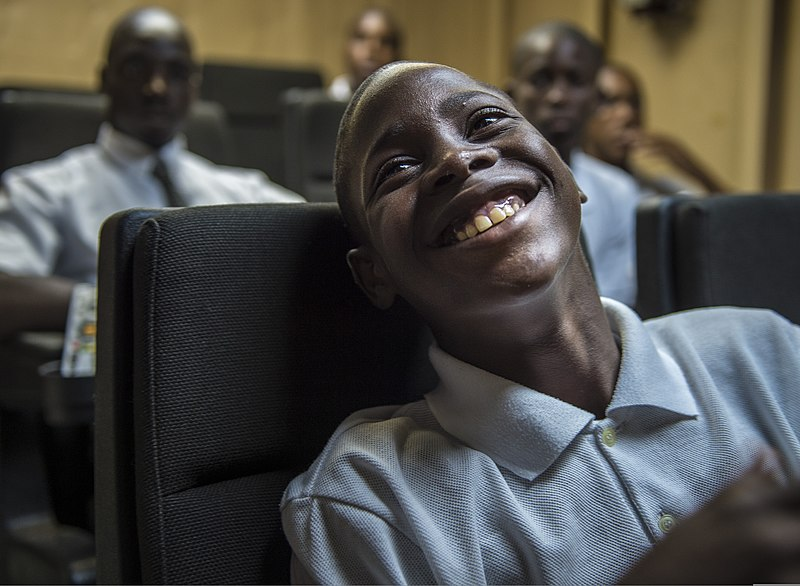 File:A student from the Boys Training Center laughs while touring the seagoing buoy tender USCGC Oak (WLB 211) May 27, 2013, in Castries 130527-N-KL795-101.jpg