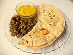 A thali with daal roti bhindi ki sabzi and mango pickle.jpg