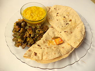 Cuisine of Uttar Pradesh - A staple meal from UP, consisting of sabji, daal and rotis with mango pickle.