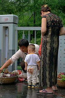 A woman and his kid are buying fruits.jpg