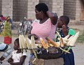 A woman selling burnt fresh maize.jpg