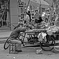 A woman sleeping on fruit stand.jpg
