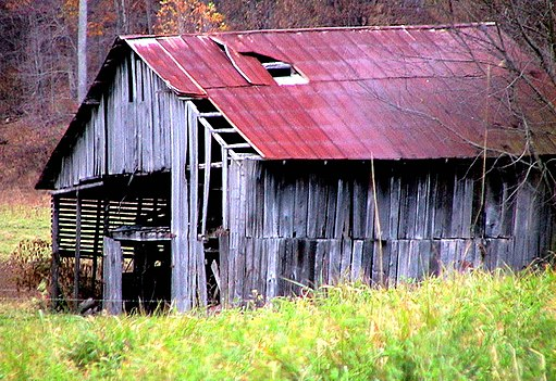 Abandoned horse barn in autumn fall