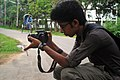 Abdullah Aarif taking photo on Wikipedia Photowalk at University of Chittagong (03).jpg