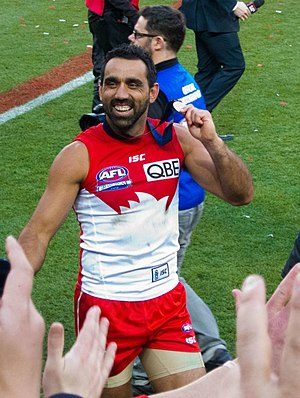 Adam Goodes - Goodes during a lap of honour after winning the 2012 AFL Grand Final