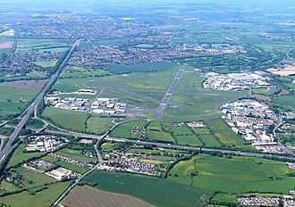 Gloucestershire Airport - Gloucestershire airport in 2017, looking east. On the left is the straight A40 road and at the bottom the M5 motorway.