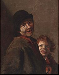 A young man with a coin in his hand and a child laughing