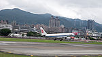 Air China Airbus A330-343 B-6523 on Final Approach at Taipei Songshan Airport 20150321d.jpg