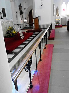 Altar rail barrier or low rails in front of the altar of a church