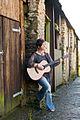 Ange Hardy standing with Martin 000-16 guitar.jpg