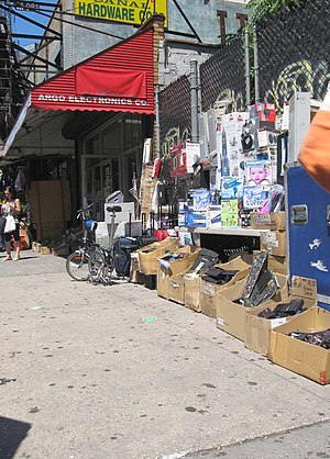 Radio Row - Sidewalk bins of a surviving shop at 393 Canal Street