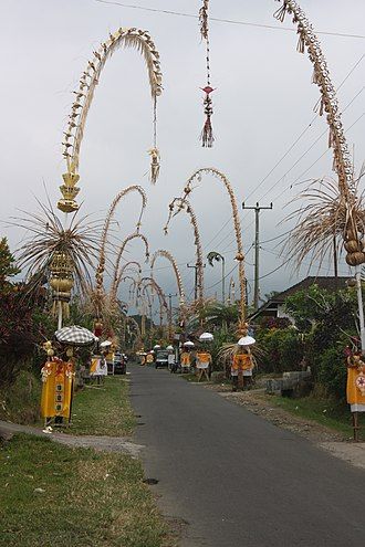Christmas in Indonesia - Penjor as street decorations for Christmas in Bali.