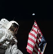 Astronaut Harrison 'Jack' Schmitt, American Flag, and Earth (Apollo 17 EVA-1)