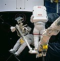Astronauts Musgrave and Hoffman during First STS-61 Extravehicular Activity (28051107481).jpg