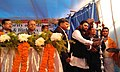Babul Supriyo lighting the lamp to inaugurate the construction of five numbers of Foot Over Bridges (FOB)s on NH-2, at a centralized function, in Andal More, Paschim Bardhaman, West Bengal.jpg