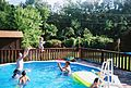 Baby tossed to catcher in pool.jpg