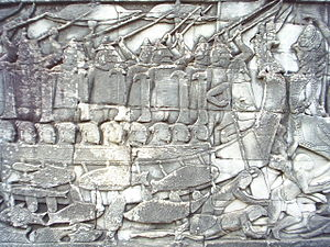 Bayon - A scene from the southern gallery depicts a naval battle; this section shows Cham warriors in a boat and dead Khmer fighters in the water.