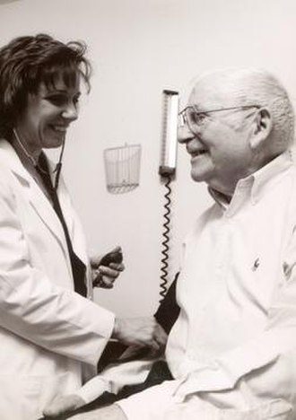 Primary care physician - A patient having his blood pressure measured