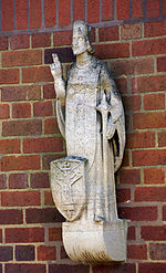 Bloye sculpture of St Alphage on Infant School Solihull.jpg