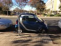 Blue smart car illegally parked.jpeg