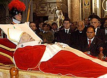 Pope John Paul II lying in a coffin