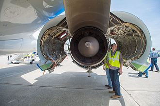 Pratt & Whitney PW1000G - Underneath the wing of an A220  with cowlings open