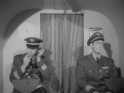 A visible boom mike in a cockpit scene.