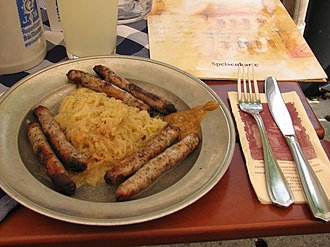 Bratwurst - Nürnberger Bratwurst with sauerkraut and mustard, as served in the Nürnberger Bratwurst Glöckl in Munich