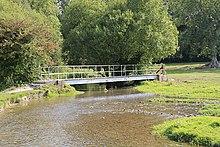Narrow river between two fields