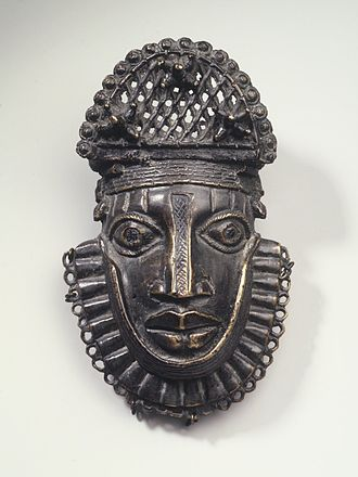 Benin court and ceremonial art - Hip ornament with face of Uhunmwun-ekue, from the collection of the Brooklyn Museum