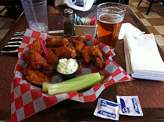 Chicken as food - Buffalo wing, invented in Buffalo, New York, is an unbreaded chicken wing that is generally deep-fried then coated or dipped in a sauce. It is now a staple in the cuisine of the United States.