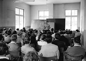 1957 in music - Karlheinz Stockhausen lecturing on his Klavierstück XI at Darmstadt in July 1957
