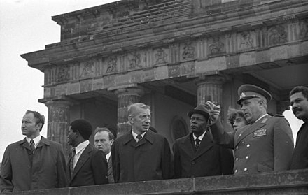 Dos Santos (fifth from the left) at the Brandenburg Gate during a 1981 state visit, with East German officials - José Eduardo dos Santos
